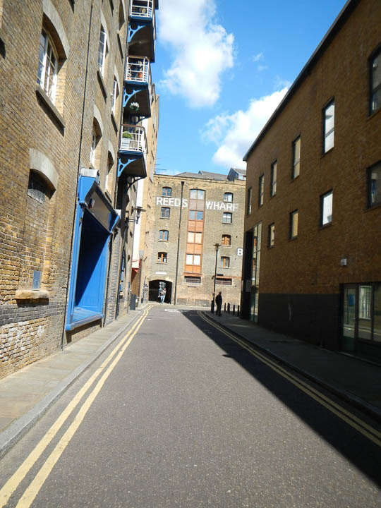 Wharf buildings crowding the street on the south bank, now flats and offices