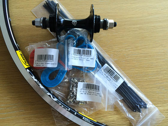 Delivery of parts from Rose Bikes; rim and hub from Bicycle Ambulance