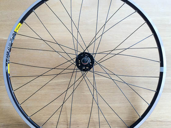 As you tension the spokes, the wheel will start to look like one