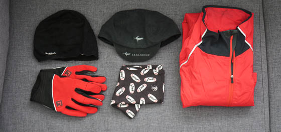 Woolly and waterproof hats, waterproof jacket, spare long-finger gloves, yacf Buff