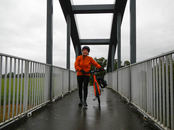 Susan crossing the footbridge over the A11